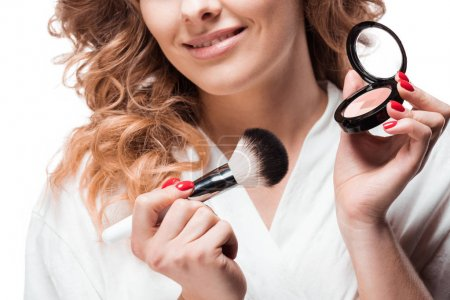 Photo for Cropped shot of smiling blonde woman holding blush and makeup brush - Royalty Free Image
