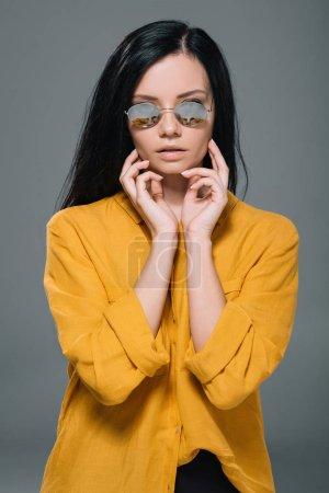 brunette woman in yellow blouse