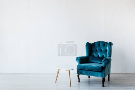 comfortable armchair near coffee table in living room