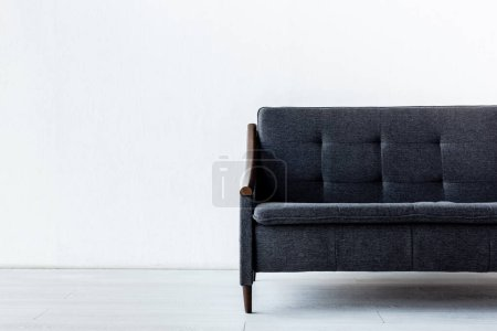 Photo for Modern sofa near while wall in living room - Royalty Free Image