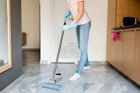 Photo for Cropped view of woman in rubber gloves washing floor at home - Royalty Free Image