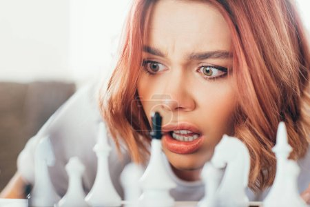 Photo for Confused girl playing chess on self isolation, selective focus - Royalty Free Image