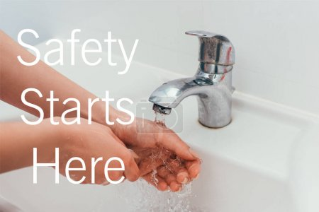 Photo for Cropped view of girl washing hands on quarantine with safety starts here lettering - Royalty Free Image
