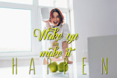 Photo for Excited girl having coffee for breakfast during self isolation with wake up and make it happen lettering - Royalty Free Image