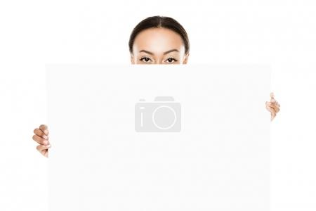 Photo for Obscured view of african american woman holding blank banner isolated on white - Royalty Free Image