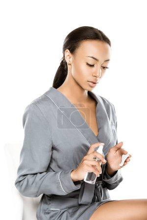 African american woman applying micellar water