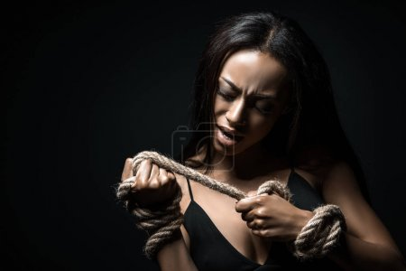 African american woman bound with rope