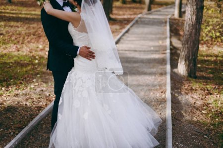 Photo for Close-up of a bride and groom in an embrace. - Royalty Free Image