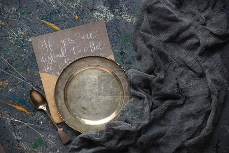 Vintage plate and calligraphy