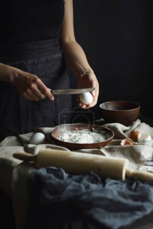 female hands preparing dough