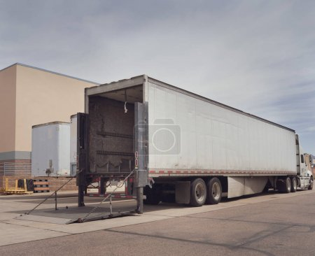 Heavy goods truck at loading depot facility