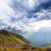 Green mountain valley under a dark dense clouds