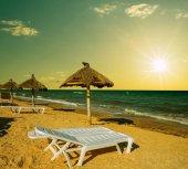 sandy sea beach scene at the sunset