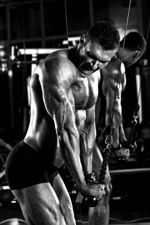 very power athletic guy bodybuilder,  execute exercise with gym