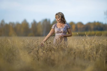 mature woman in wheat field