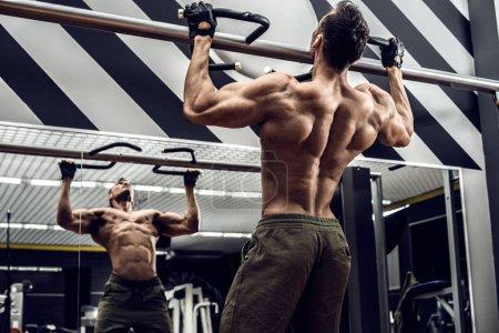 bodybuilder pose in gym
