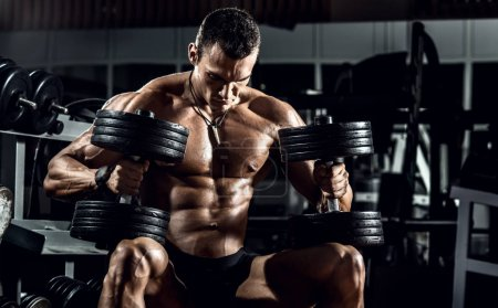 Photo for Very power guy - bodybuilder, execute exercise with weight, inside gym, horizontal photo - Royalty Free Image