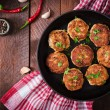Juicy delicious meat cutlets in pan on a wooden ta...