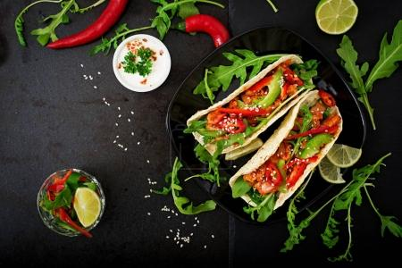 Mexican tacos with paprika and arugula