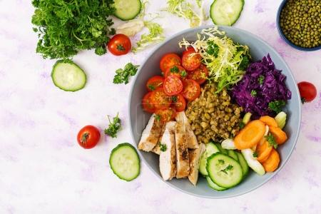 Photo for Healthy salad with chicken, tomatoes, cucumbers, lettuce, carrots, celery, red cabbages and  mung beans on light background. Proper nutrition. Dietary menu. Flat lay. Top view - Royalty Free Image