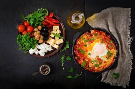 Fried eggs with vegetables shakshuka