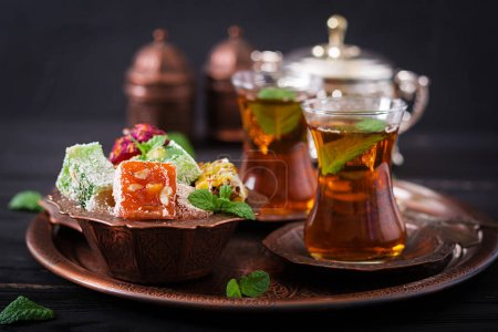 Bowl with turkish delight and black tea