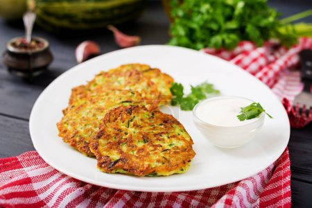 Zucchini pancakes on white plate