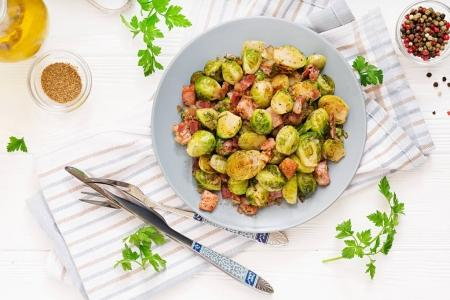 roasted brussels sprouts with bacon on plate