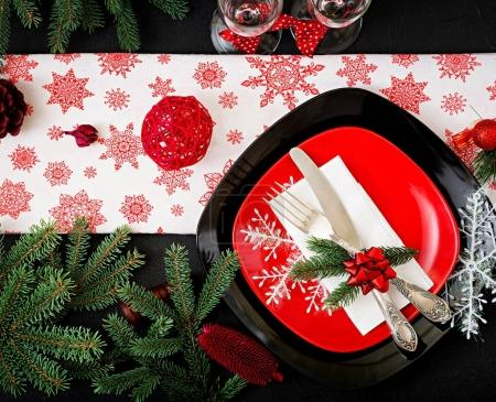Traditional dishware on decorated Christmas table
