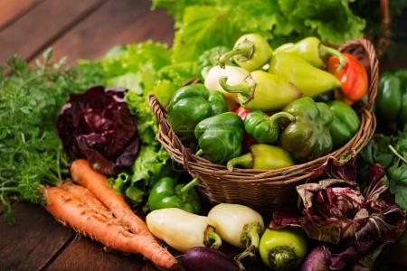 Photo for Assortment of vegetables and green herbs. Market. Vegetables in a basket on a dark background - Royalty Free Image