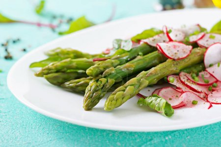 Photo for Salad with asparagus, radish and chard, vegan healthy food - Royalty Free Image