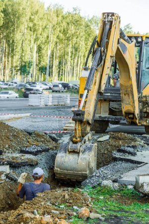 Excavator working outside on road