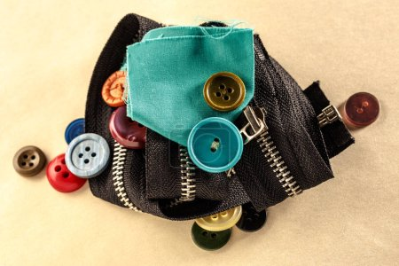 Colourful buttons, zipper and cloth