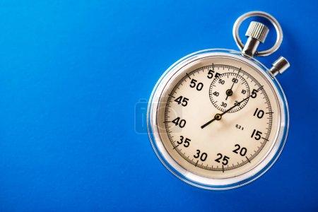 Stopwatch on blue background