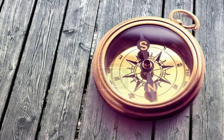 Photo for Vintage brown wooden compass, close-up - Royalty Free Image