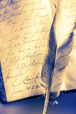 book with feather pen