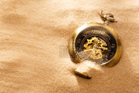 Pocket watch in beach sand