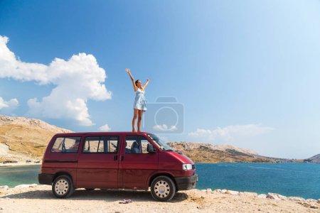 girl on a rooftop of van