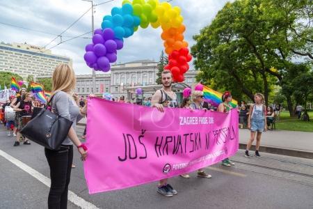 15th Zagreb pride. LGBTIQ activists holding pride banner.