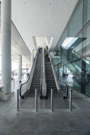 Passengers on escalators at airport
