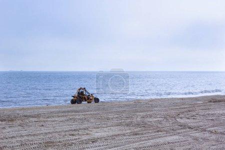 Terrain vehicle at the beach