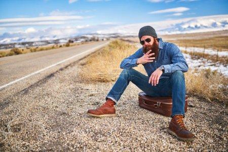 bored bearded traveler waiting