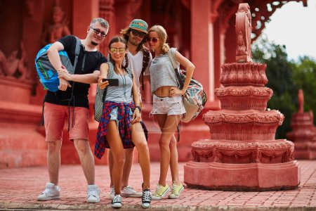 tourists taking group selfie