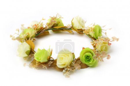 Green and white wreath of fabric flowers isolated