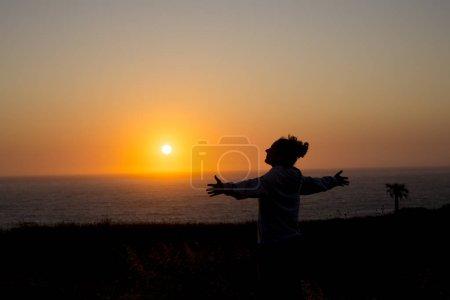 happy woman at sunset beach