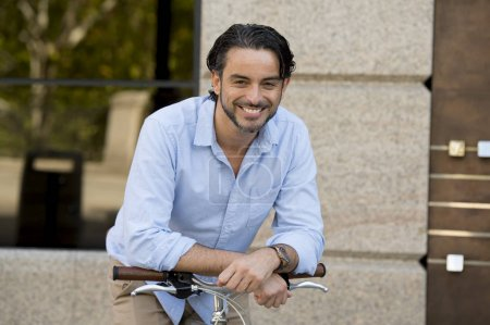happy man with vintage bicycle in city