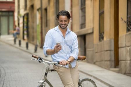 man using phone on vintage bicycle