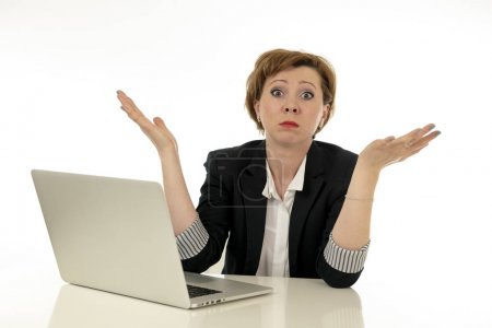 Photo for Young beautiful red haired caucasian stressed business woman working on her laptop looking worried, tired, overwhelmed and desperate. Business, overwork, deadline and technology concept. - Royalty Free Image