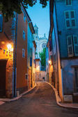View of narrow alley and church in the early evening with lamp lit, in the lovely village of Rians.