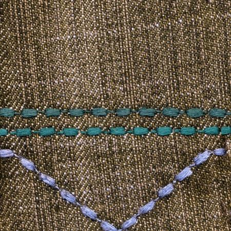 brown denim background decorated with seams